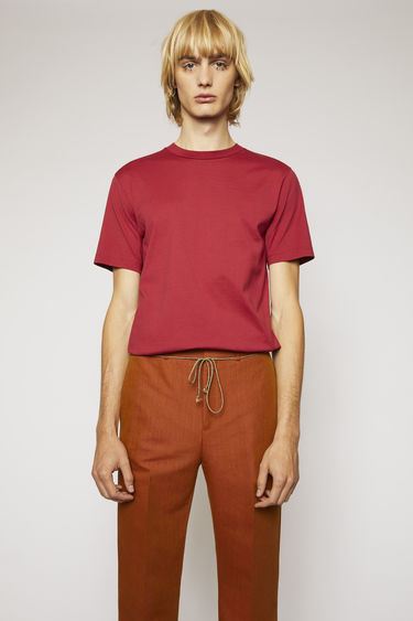 Acne Studios burgundy t-shirt is cut to a slim fit from soft cotton jersey and completed with a ribbed crew neck and short sleeves.