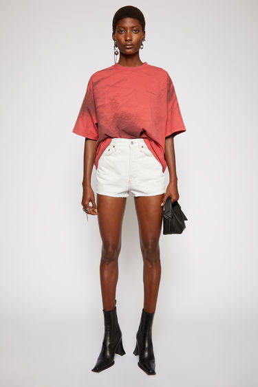 Acne Studios pale blue denim shorts is treated with a stone wash for vintage appeal and shaped to a high-rise silhouette with cropped, wide legs.