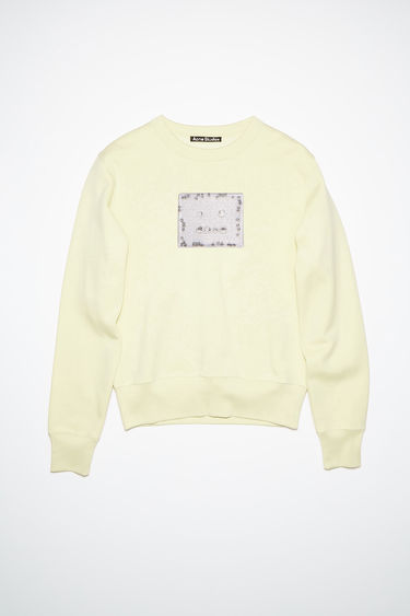 Acne Studios gold regular fit crew neck sweatshirt features a printed beaded face detail on the front.
