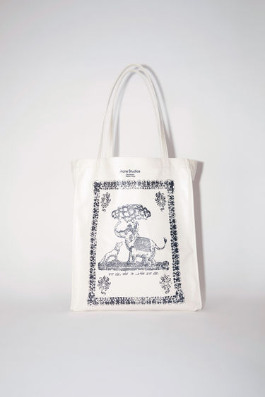Acne Studios coconut white oilcloth tote bag features Acne Studios branding.