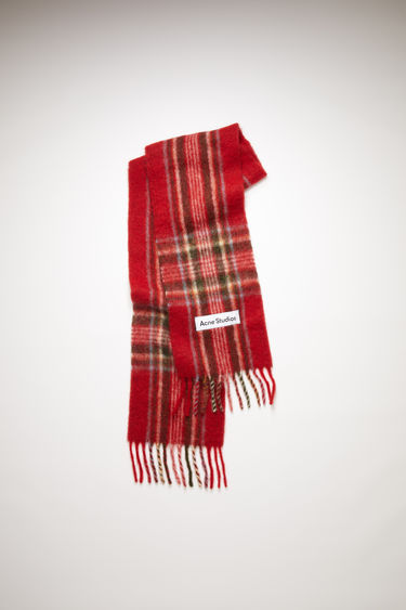Acne Studios red tartan check scarf is made of an alpaca blend with fringed ends.