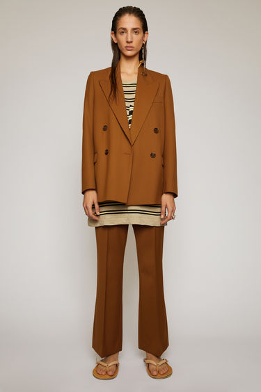 Acne Studios cognac brown wool-blend suit jacket is crafted to a double-breasted silhouette and finished with wide notch lapels and two front flap pockets.