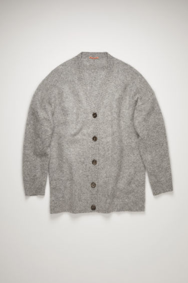Acne Studios cold grey melange cardigan is knitted from brushed wool and mohair-blend and features a V-neck and dropped shoulders to accentuate the relaxed, oversized silhouette.