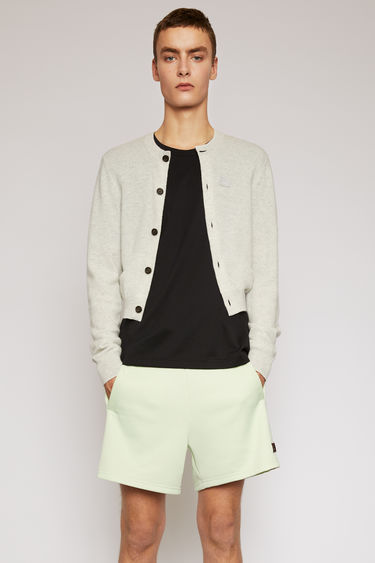 Acne Studios light grey melange cardigan is knitted from a fine gauge wool to a slim fit and finished with a tonal embroidered face patch on the chest.
