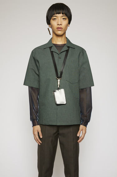 Acne Studios black/green shirt is cut to a boxy silhouette from a striped seersucker cotton and has a chest patch pocket and a cuban collar.