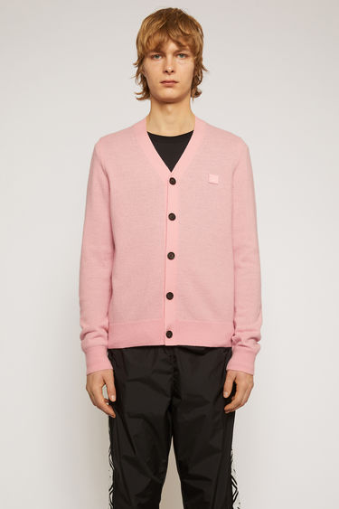 Acne Studios blush pink cardigan is knitted with a fine gauge from soft wool yarns and accented with a tonal face-embroidered patch on the chest.