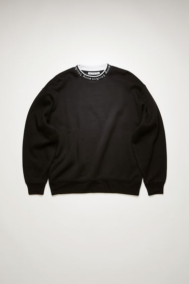 Acne Studios black oversized sweatshirt is made of a cotton blend, featuring a logo ribbed crew neck.