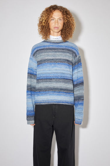 Acne Studios blue gradient striped crew neck sweater is made of a cotton/polyester blend with a classic fit.