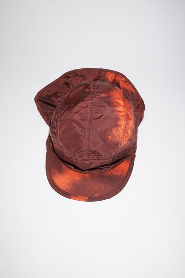 Acne Studios anthracite/multi five panel cap is made from tie-dyed repurposed lightweight nylon, with adjustable drawstring cords.