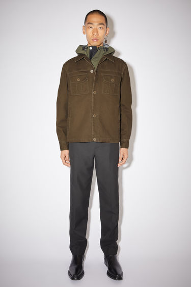 Acne Studios cedar green casual workwear jacket is made of stone washed treatment cotton with two button chest pockets.