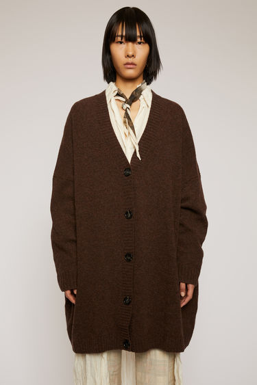 Acne Studios dark brown cardigan is knitted from lightweight Shetland wool and shaped to an oversized fit with a deep v-neck and dropped shoulder seams.