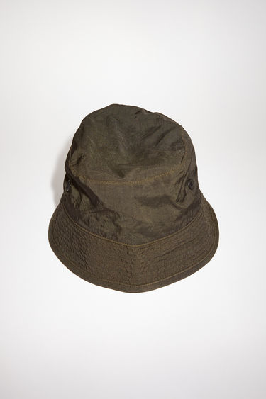 Acne Studios cedar green bucket hat is made of nylon with Acne Studios branding.