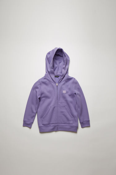 Acne Studios Mini Ferris Zip F lavender purple is a hooded sweatshirt crafted from brushed cotton fleece and finished with a tonal face patch on the chest.