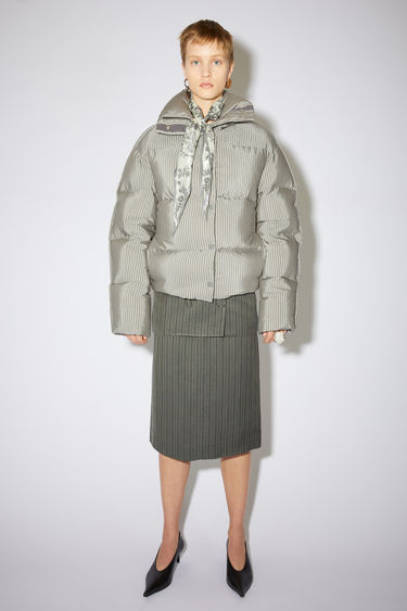 Acne Studios dark grey quilted down jacket is made of a striped cotton blend with a printed back.
