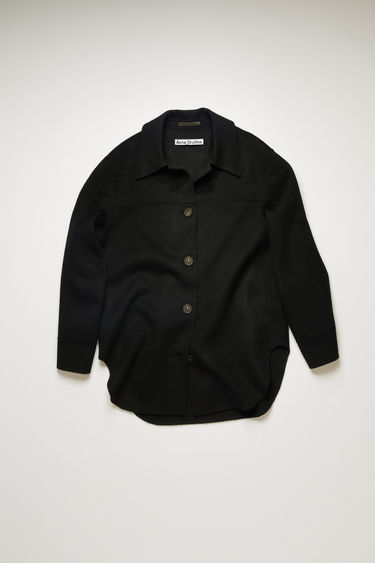 Acne Studios black overshirt is crafted from wool to an oversized silhouette and features a spread collar, dropped sleeves and a curved hem.