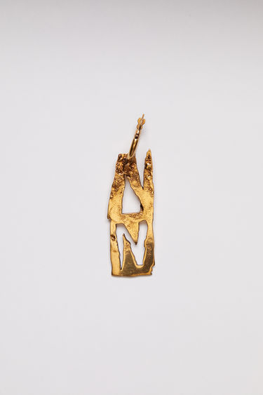 Acne Studios gold earring is crafted with a hammered pendant and features a stencil of the letter 'N', then secured via a hinge fastening.