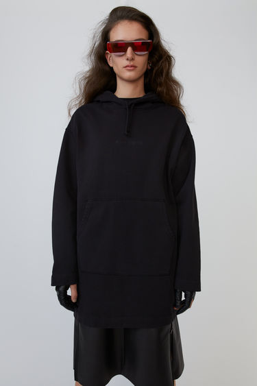 Acne Studios black hoodie dress is shaped to an oversized fit and accented with a debossed logo on the front.