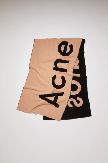 Acne Studios Toronty Logo Contrast pink/black scarf is crafted from a soft wool blend with a double weave technique and features a bold logo lettering on both sides.