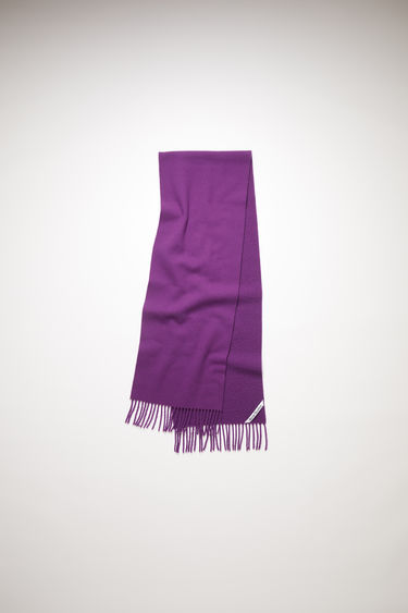 Acne Studios aubergine purple fringed scarf is made of brushed wool with a pilled effect.