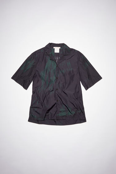 Acne Studios dark green short sleeved shirt is made from tie-dyed repurposed lightweight nylon cut for a casual fit featuring a symbol print in the back.