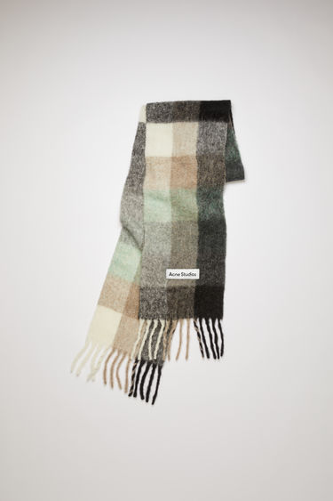 Acne Studios green/grey/black large scale check scarf is made of an alpaca blend with fringed ends.
