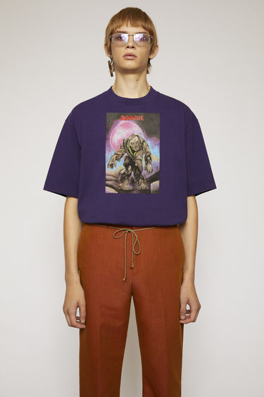 Acne Studios launches an exclusive capsule with Monster in My PocketⓇ. As part of the collaboration, this deep purple t-shirt is made from brushed cotton jersey and features a zombie print on front.
