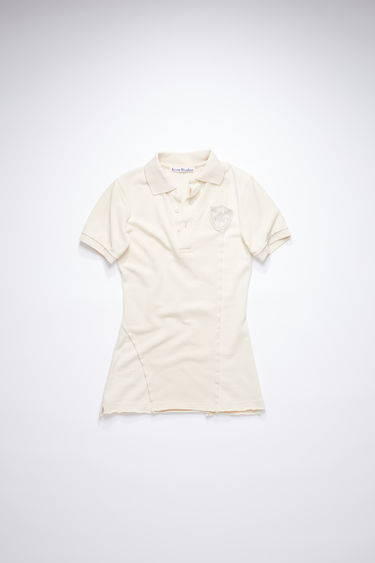 Acne Studios coconut white short sleeve polo shirt is made of cotton with a straight fit.