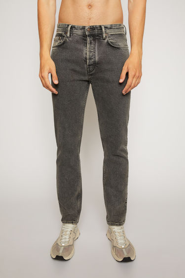 Acne Studios River Black Pepper jeans are crafted from comfort stretch denim that's stonewashed to give a worn-in appeal. They're shaped to sit high on the waist before falling to a slim, tapered leg.