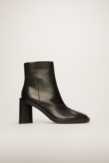 Acne Studios black ankle boots crafted from soft calf leather, shaped with squared toe and triangular block heel.