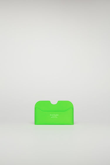 Acne Studios Elmas fluo green cardholder is crafted from smooth leather with white logo lettering at the front and offers three card slots.