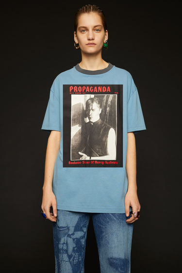 Acne Studios blue t-shirt is crafted from lightweight slubbed cotton and features prints from the Propaganda Magazine on front.