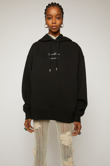 Acne Studios black hooded sweatshirt is crafted from cotton fleece with an oversized fit and accented with a broken logo.