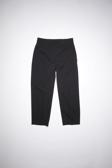 Acne Studios black wool-blend trousers are cut to a tapered-leg fit with a mid-rise waist and neatly finished with two front slip pockets and one jetted pocket at the back.