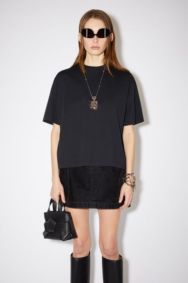 Acne Studios black short sleeve t-shirt features a ribbed crew neck and an Acne Studios logo tab.