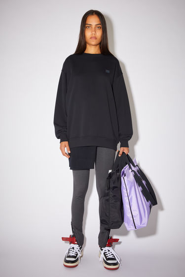 Acne Studios black sweatshirt is crafted from midweight loopback fleece to a loose silhouette and finished with a face-embroidered patch on the chest.