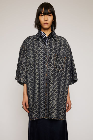 Acne Studios indigo blue shirt is crafted from denim that's jacquard woven with a pinecone motif and cut to an oversized fit with dropped shoulder seams.