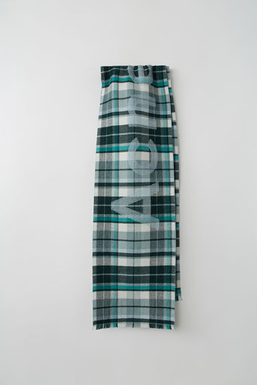 Acne Studios mint/pastel green skinny check scarf is crafted from soft compact wool and detailed with Acne Studios logo.