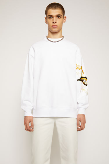 Acne Studios optic white sweatshirt is made from organically grown cotton and features a print of dolphins overlaid with a tonal logo. It's cut for a relaxed silhouette with a ribbed round neck and dropped sleeves.With every purchase of this item, Acne Studios makes a donation towards MareCet, a grassroots marine conservation organisation that helps protect critically endangered species of similar descent and their vulnerable habitats.