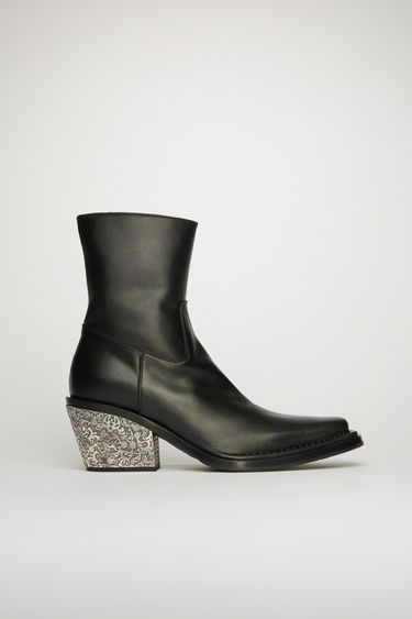 Acne Studios black leather boots are crafted to a Western-inflected silhouette and set on a stacked cuban heel, accented by an engraved silver-tone metal plaque.