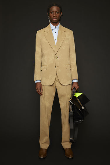 Acne Studios hazel beige/taupe suit jacket is crafted from a washed-out cotton twill and features two ring button closures and neatly pressed creases on front darts.
