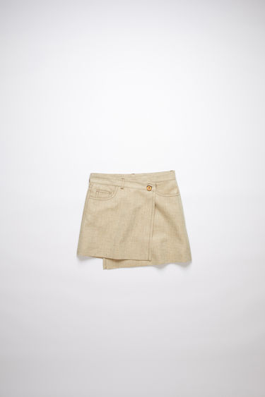 Acne Studios camel beige casual skirt is made of a hemp blend with an asymmetric button closure.