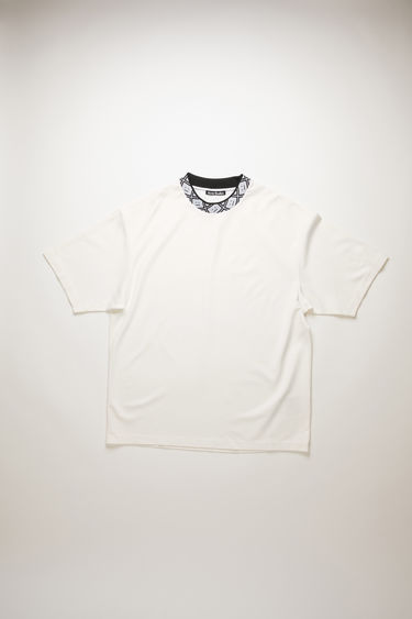 Acne Studios optic white t-shirt is cut to a relaxed silhouette from midweight stretch jersey and features a ribbed mock neck inlaid with a face-jacquard design.