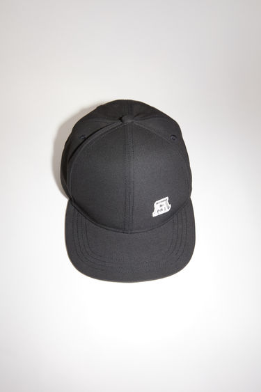 Acne Studios black baseball cap has a classic six panel design, featuring a logo patch on the front.