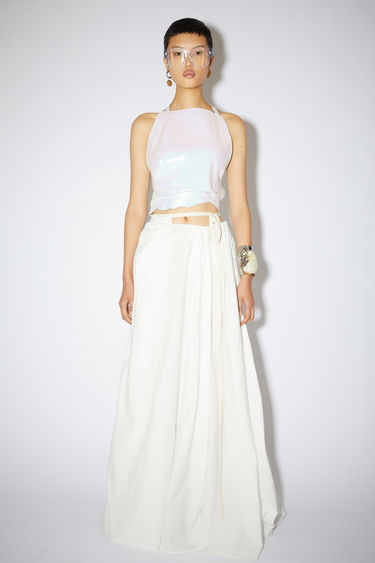 Acne Studios white floor length wrap skirt is made of a cotton blend.