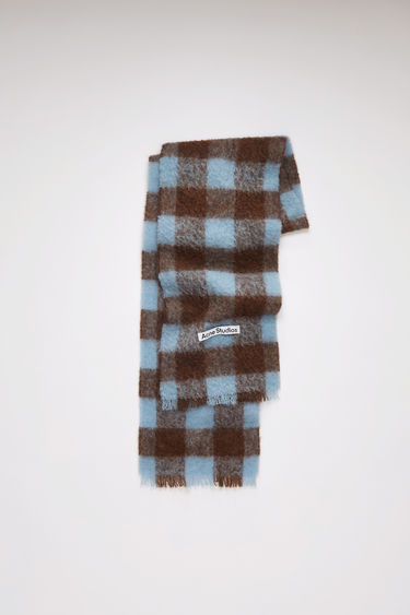 Acne Studios brown/light blue scarf is spun from a blend of alpaca, wool and mohair yarns in a relaxed long-length silhouette that drapes through the body. It's finished with a soft, brushed texture and a logo patch above the fringed edges.