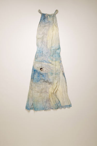Acne Studios blue/white apron dress is crafted from crinkled linen and features a painting of Swedish nature by August Strindberg with hand-embellished crystals. It's shaped with a gathered halter neck and secured with twisted ties that cross-over the open back.