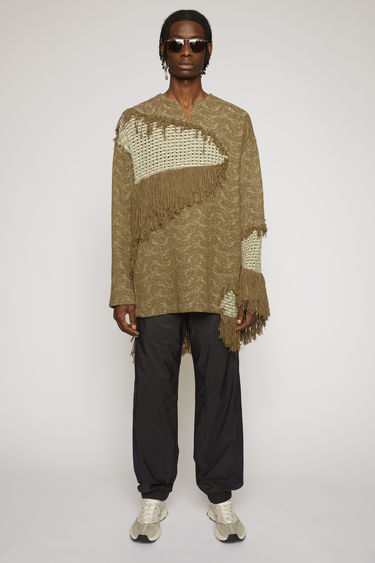 Acne Studios mushroom beige/pale green tunic is woven in a subtle ripple pattern and features basketweave panels with fringed trims.