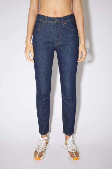 Acne Studios Melk Indigo jeans are crafted from comfort stretch denim that's washed for a soft, faded finish. They're shaped to sit high on the waist with slim legs that taper and crop at the ankles.