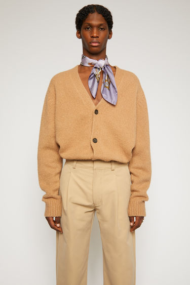 Acne Studios light brown cardigan is knitted from soft wool and cashmere-blend yarn and has a V neckline and drop-shoulder sleeves to frame the relaxed shape.