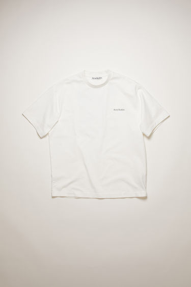 Acne Studios optic white t-shirt features a dinosaur print and a patch adorned at the back. It's crafted from organically grown cotton that's garment dyed for a soft handle and shaped to a relaxed silhouette with dropped sleeves.
